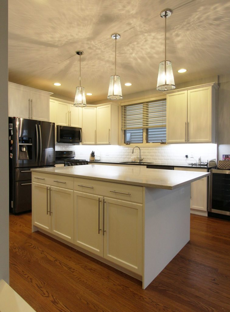 Image of painted cabinetry and new countertops in value maximized kitchen
